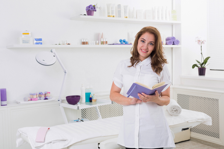 Woman beautician doctor at work in spa center. Portrait of a young female professional cosmetologist. Female employee in cosmetology cabinet or beauty parlor. Healthcare occupation, medical career
